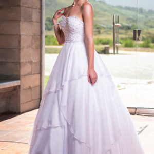 Elegant wedding gown with pearl lace bodice and soft chiffon skirt. Includes tulle underskirt. Proudly designed and manufactured in South Africa.