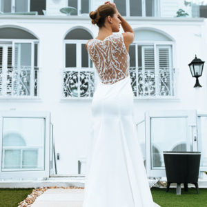 Classic pearl and satin duchess wedding dress with lace back. A V-neckline dress with a classic silhouette and subtle detail.