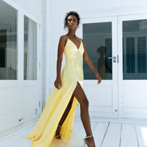 Looking for head-turning eveningwear? Our beautifully textured Cannery yellow satin dress is the ultimate designer investment.