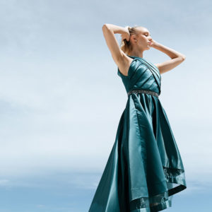Satin teal green dress with detailed bodice.