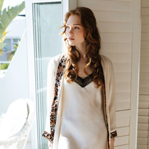 Luxurious and soft off-white silk dressing gown with contrast trimmings.