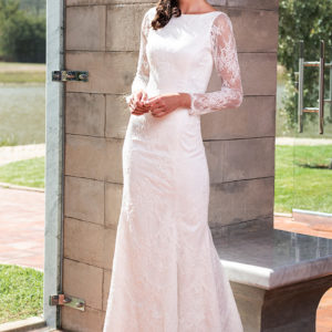 Chantilly lace wedding dress designed and manufactured in South Africa.